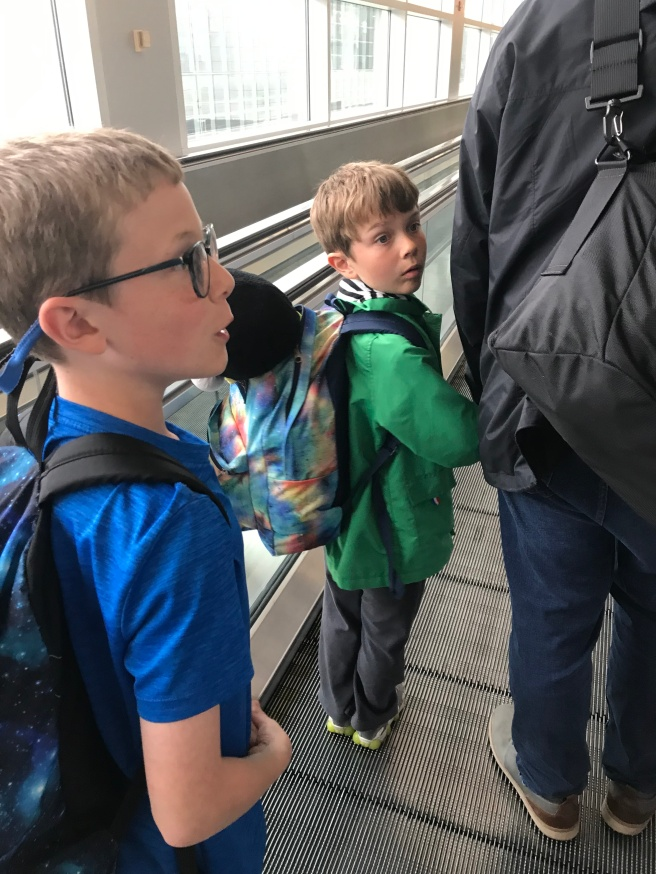Kids on a moving sidewalk in an airport