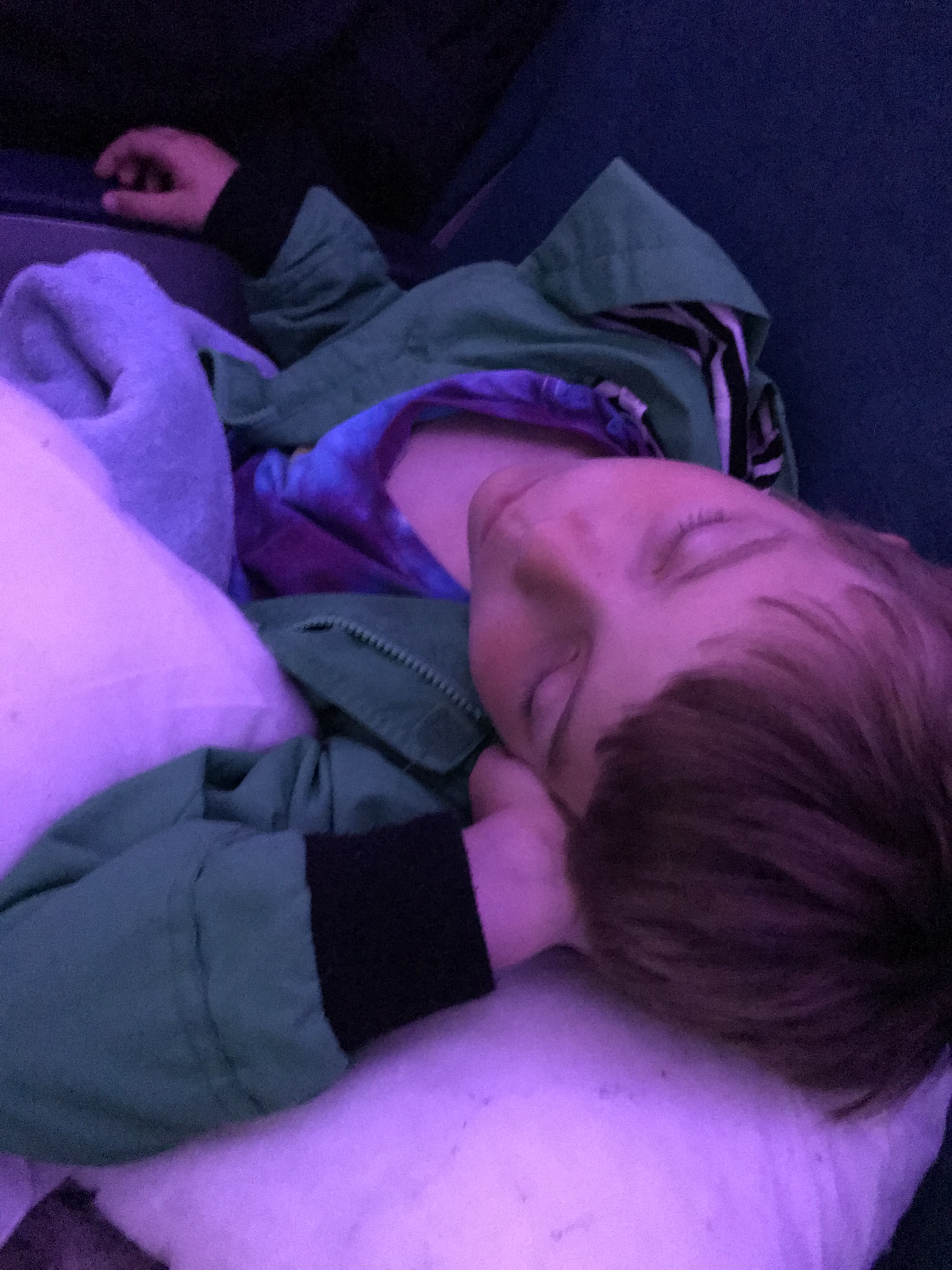 Child sleeping in an airplane seat