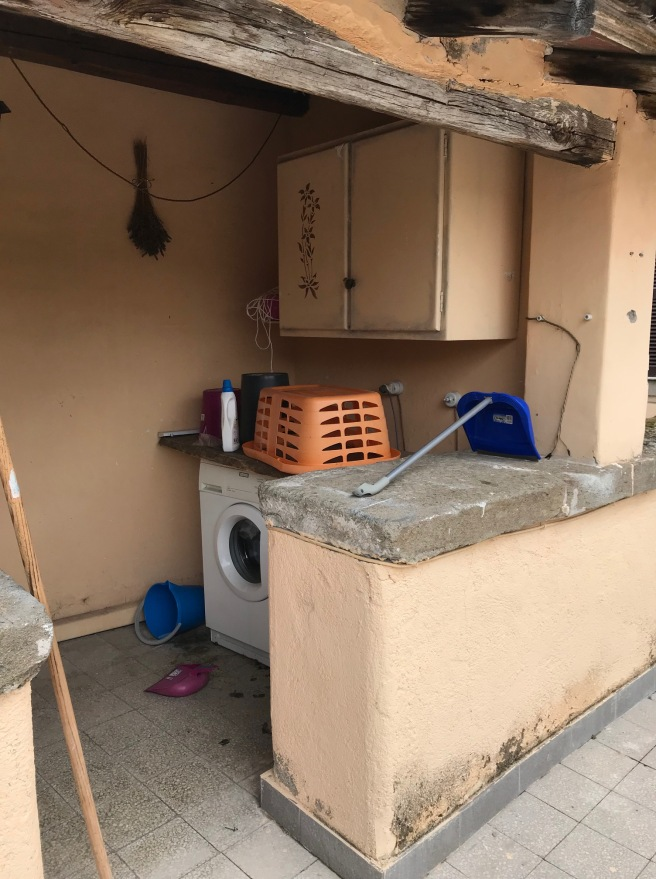 A small outdoor laundry area