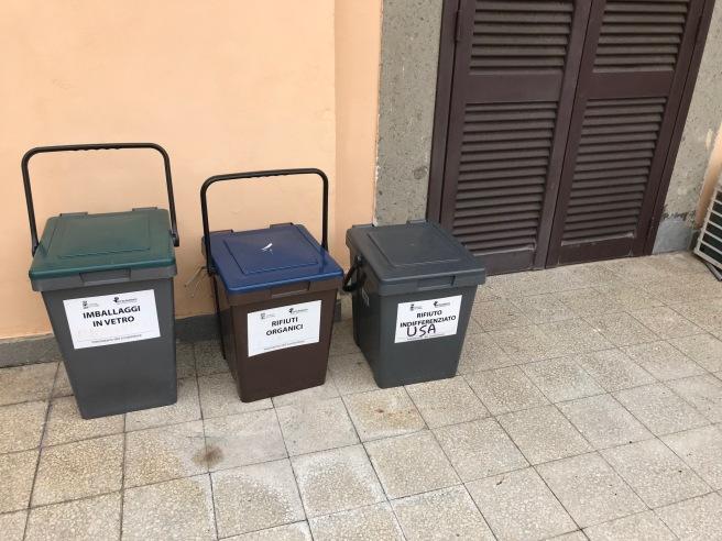 A row of trash bins